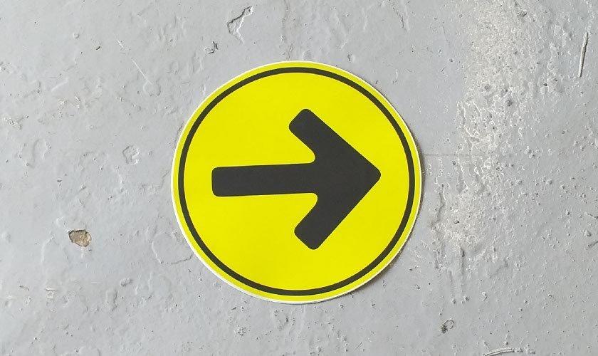 Yellow Direction Arrow Floor Sticker on painted floor
